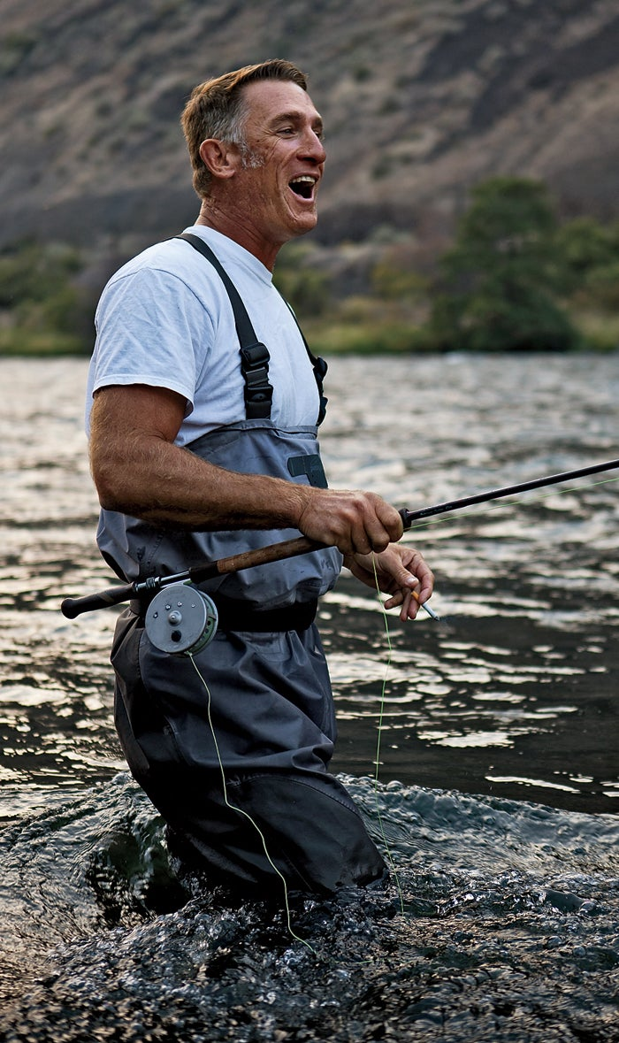 Joe laughs as a steelhead slips off his line. Steelhead are rainbow trout that begin in freshwater, spend many years in the ocean, then return to their native rivers to spawn. They grow bigger, fight harder, and shine a brighter silver than rainbow trout that never leave freshwater.