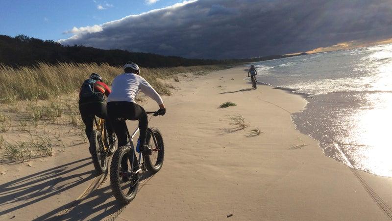 Three fat bikers on a Lake Michigan Beach.