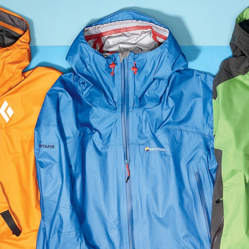 """Best For: Moving fast in wet weather.  The Test: The Featherlite ($399) weighs about an ounce more than the pared-down Black Diamond, but it's a slightly different animal. Here you get two front pockets, smartly positioned high enough not to interfere with a harness or hipbelt, and a more functional hood—with three points of adjustability and a wire-stiffened brim. """"I could really hunker down in it,"""" said one tester. """"Nothing was able to sneak in."""" All else being equal, the Featherlite's eVent fabric is probably a bit more breathable than Gore-Tex's Paclite. Note: the fit is especially trim, so size up if you're brawny or looking to wear an insulating midlayer. The Verdict: Light on weight, not on features. 10 oz; montane.co.uk Breathability: 3 Weatherproofness: 5"""