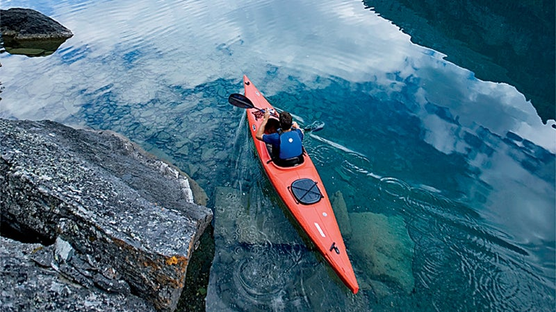 Paddling the park's glassy waters.