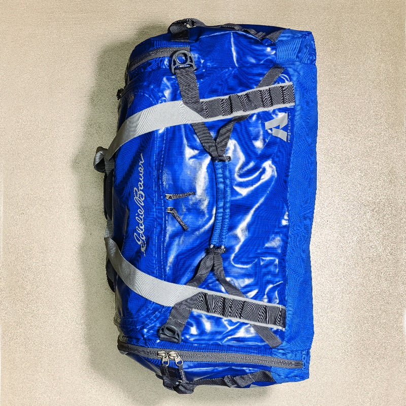 This is a serious expedition bag ($149) made from tough, waterproof, TPUcoated polyester. Testers appreciated the four padded grab handles, which made it easy to yank on and off roof racks, as well as the legit backpack straps. Bonus: when you're home, this 90liter duffel collapses to become its own storage pouch. eddiebauer.com
