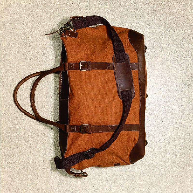 """A throwback in the best ways: vintage looks, organic waxed canvas, and leather straps and trim ($148). It's big enough for a getaway (roughly 30 liters) but compact enough to take to the coffee shop. The """"Blue"""" in United by Blue? For every product purchased, the Philly startup removes a pound of trash from waterways. unitedbyblue.com"""