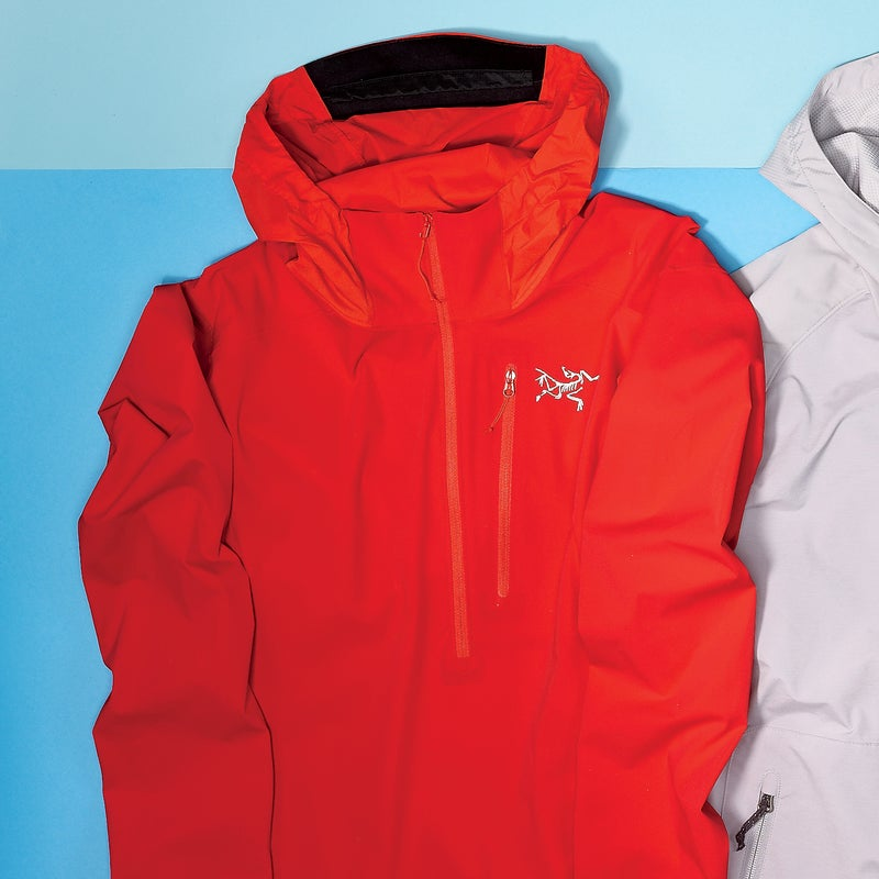 Best For: Moving fast in the mountains.  The Test: Cut from a tightly woven, stretchy nylon-elastane blend, the lightweight Psiphon ($149) is purpose-built for rock climbing. The hood can be adjusted with one hand, the stretchy cuffs are designed to stay put when you push them up on your forearms, and two small removable pieces of foam on each side of the waist hem keep the jacket from riding up under your harness. Our favorite feature is the hood stow-away system: a snap keeps it rolled tightly (and not flapping around) when you don't need it.  The Verdict: You don't have to rock-climb to dig it. We happily ran, biked, and hiked in the Psiphon for months. 10.2 oz; arcteryx.com Breathability: 4.5 Weatherproofness: 3