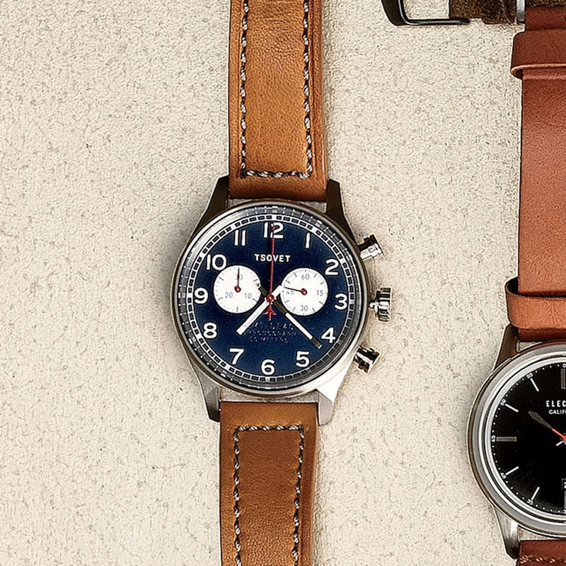 We were immediately smitten with the eye-pleasing blue face on this low-key, less burly model from Tsovet ($450). The big numbers and two subdial timers are clean and easy to read, and the 40-millimeter dial is just the right size. The leather band and embossed lettering on the face add to the old-school vibe on this handsome traveler's piece. tsovet.com