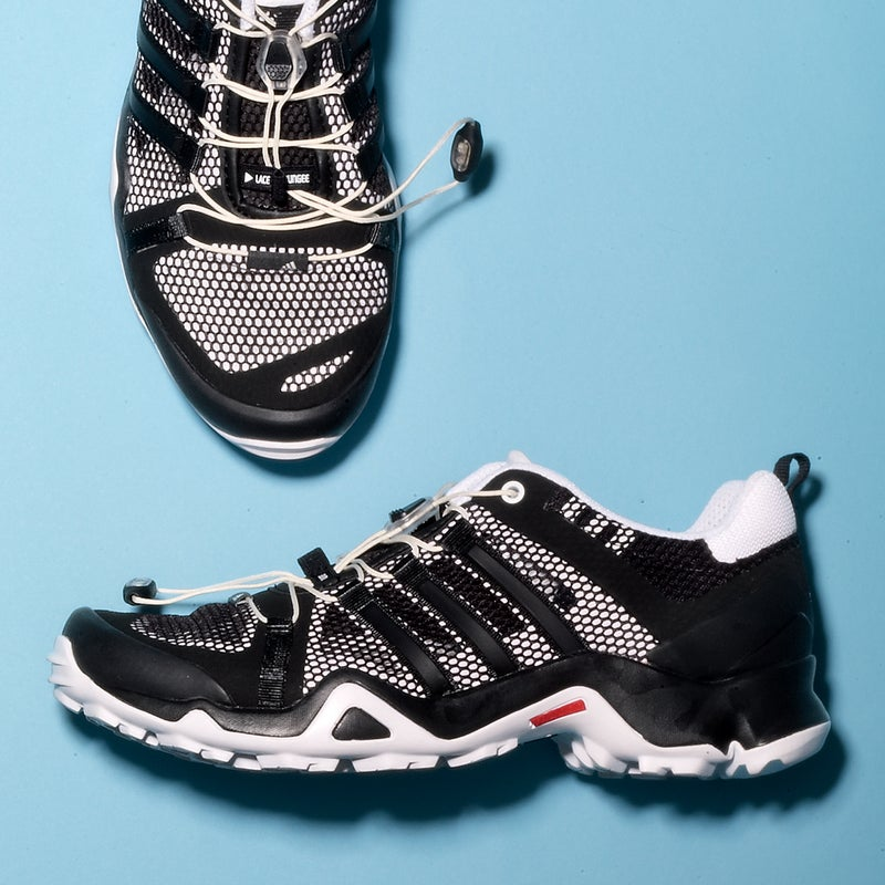 """Best For: Stream crossings. The Test: With lots of breezy mesh and a high-traction tread, the Breeze ($110) is somewhere between a hiking boot and a water shoe. It's not an ideal hybrid—that airy upper can get gummed up on sandy trails—but the solid chassis and reinforced heel and toe cup held up well over jagged rocks. """"With most mesh shoes, I'd be scared of ripping my feet to shreds on technical terrain,"""" said one tester. """"But I felt totally comfortable."""" When it's used as a water shoe, the EVA tongue and molded liner are plenty comfy, and it dries fast. The Verdict: A tough, low-cut hiker that's happy wet. 11.5 oz; adidas.com Comfort: 3.5 Traction: 5"""