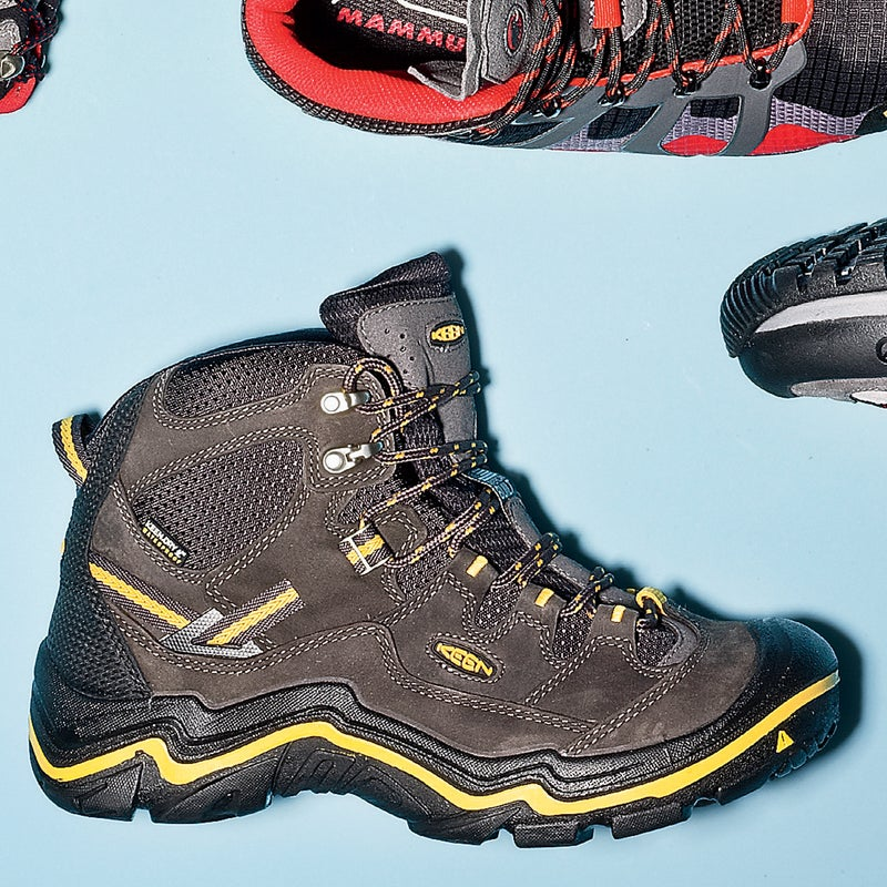 """Best For: All-around performance. The Test: """"Cushy like a Cadillac, dependable like a Toyota truck"""" is how one tester summed up the Durand ($180). Lots of padding and an extra-wide toe box kept feet comfy on longer days, and tough nubuck leather held up like a champ after multiple thrashings through rocky scree fields. Built with Keen's proprietary polyurethane midsole, the boot is supremely stable. The outsole features grippy rubber that one over-amped tester insisted helped him jump around on wet rocks """"like Spider-Man.""""  The Verdict: One boot to rule them all—light enough for day hikes, sturdy enough for backpacking. 1.3 lbs; keenfootwear.com Comfort: 5 Traction: 4"""