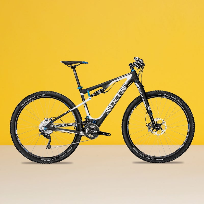 """Best For: XC racers on a budget.The Test: Making its U.S. debut with this lightweight 29er ($3,799), the popular German brand surprised us with near telepathic handling and greyhound speed. """"Stand on pedals, rocket forward,"""" said one tester. Just as you'd expect from a four-inch cross-country racer, it bumped around on rough trails. But the stiff RS-1 fork—controlled, along with the rear shock, from a single bar-mounted lever—did an impressive job of smoothing out minor chatter. With a full Shimano XT group set and carbon bits from FSA, the Wild Edge is a real bargain, especially since the fork alone sells for almost half the bike's retail price.The Verdict: The best deal we've seen for a carbon racer. 25 lbs; bullsbikesusa.comClimbing: 4.5Descending: 3"""