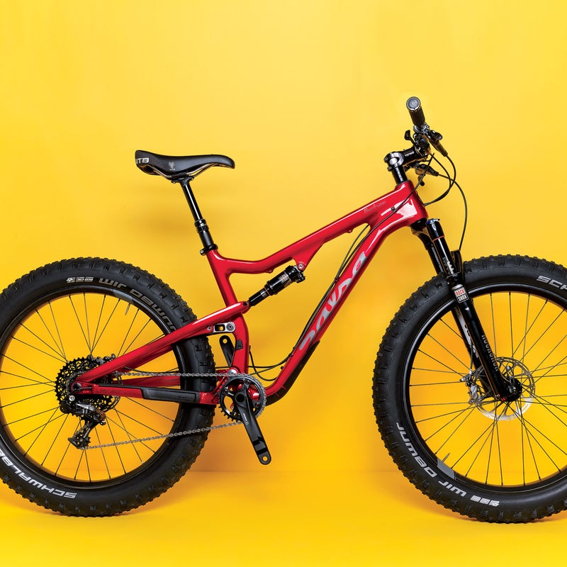 """This full-suspension fatty ($6,499)with four-inch Schwalbe Jumbo Jim tires latched onto loose rubble like Velcro, letting testers motor through scree that left skinnier rubber spinning. """"You almost can't lose traction,"""" said one tester as he skipped up and downsteeps he'd never ridden before. The reasons we liked the Bucksaw Carbon the best? Read the full Gear of the Year review.Climbing: 4.5Descending: 5"""