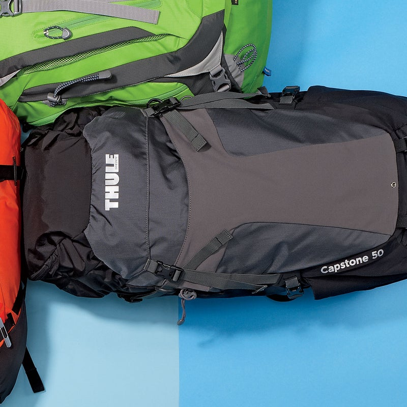 """Best For: Smooth operators.The Test: We're huge fans of Thule's sleek and sturdy travel luggage, so we weren't surprised by how much testers liked the Capstone ($200). The torso-adjustment system moves up and down on a track, making it easy to tweak fit on the fly without futzing around with straps—you just push a button and slide. The fabric is thick Cordura, the suspension system is sturdy, and it's so well built and comfortable to wear that we'd tell you to go ahead and overload it, except you can't: the top lid is fixed in place.The Verdict: """"If Apple designed packs, this is what they'd look like,"""" said one tester. 3.3 lbs; thule.comComfort: 4.5Versatility: 3"""