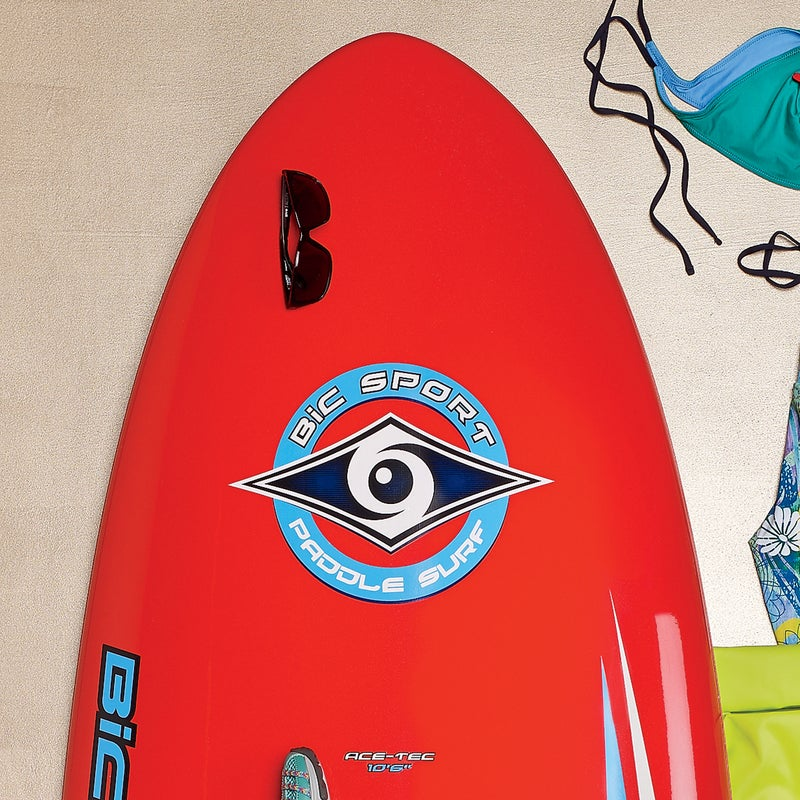 """The 26-pound ACE-Tec ($1,150) is happy cruising lakes, running river rapids, and paddling into an overhead set. The 31.5-inch width and refined rocker deliver glide in flatwater, and the three-fin thruster setup surfs well in a range of conditions. 10'6"""" and 11'6""""; bicsup.com"""
