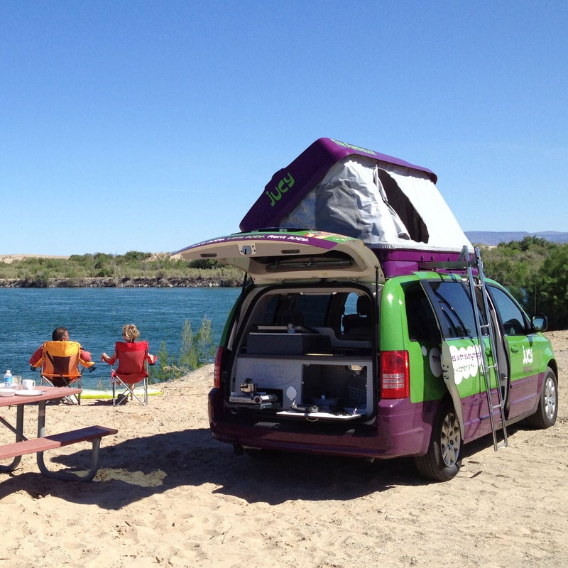Exported from Australia to the United States in 2012, cheery green Jucy minivans sleep up to four. Pop the tent on top or sleep inside: The passenger seats morph into a bed. Vans also have a screw-in table, fridge, gas-burner stove, and sink in the trunk, plus a TV and DVD player that fold down from the ceiling. Pickup in San Francisco, Los Angeles, or Las Vegas. Rates start at $40 per night. jucyrentals.com