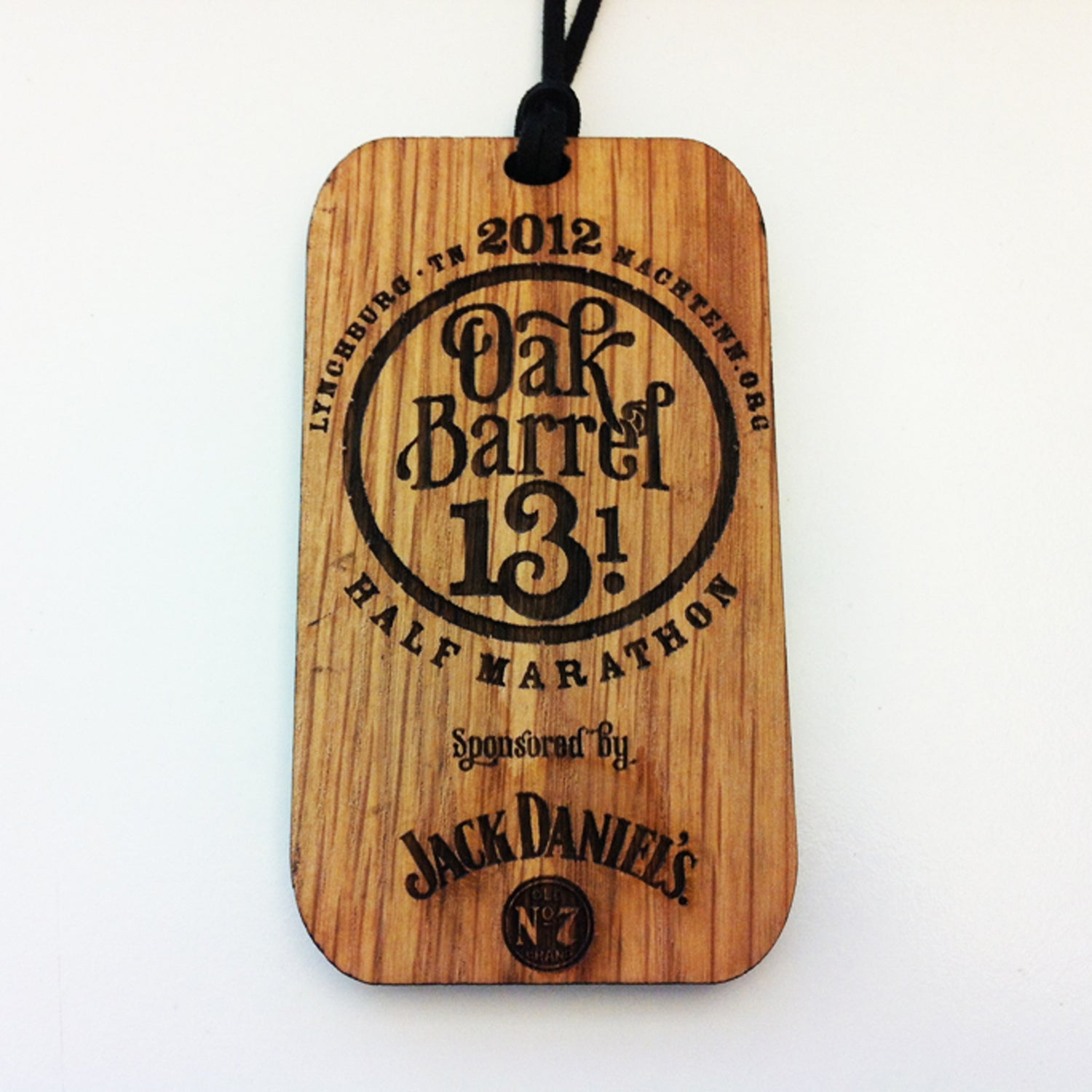 Solera: With so many medals made of its homonym, it's refreshing to see one made of wood. Sponsored by Jack Daniels, this event gives each finisher a medal that looks as if it were dipped and aged in whiskey. Burnt edges and a leather strap give this memento a lot of Southern charm and character. In keeping with the theme, age group winners received a wedge of a whiskey barrel.