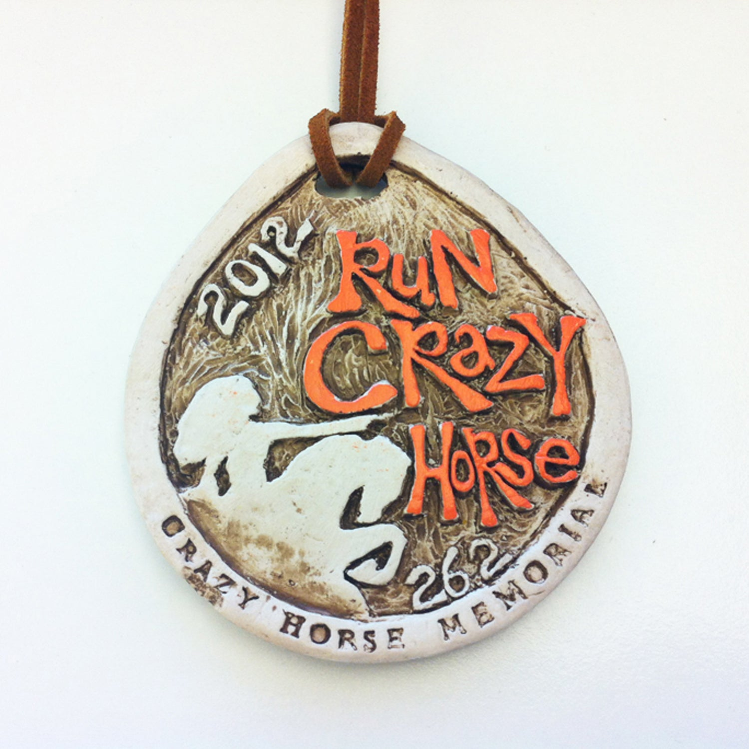 Solera: I love this medal's grit and chiseled shape, even though the design borrows very heavily from the Big Sur International Marathon medal. It features the event's titular sculpture, with Crazy Horse himself pointing forward, as if directing runners to follow the 26.2-mile path to glory. Made from clay and featuring a hand-tied leather strap, you might suspect your medal was the only one made.