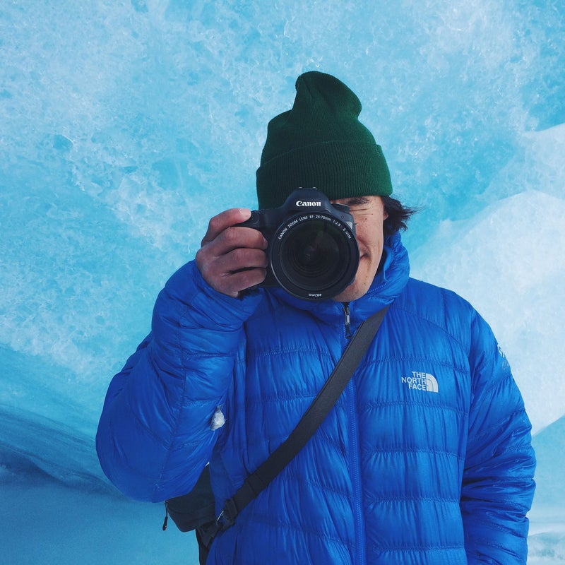 Chin frames up another perfect square in a seasonal ice cave that forms on the Athabasca Glacier.