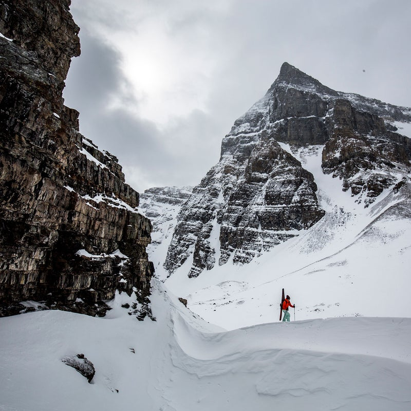 The dry winter also meant good snow stability. Here, Thorien makes her way up the backside of Surprise Pass, out of Lake Louise. The couloirs on the other side descend right to the lake.