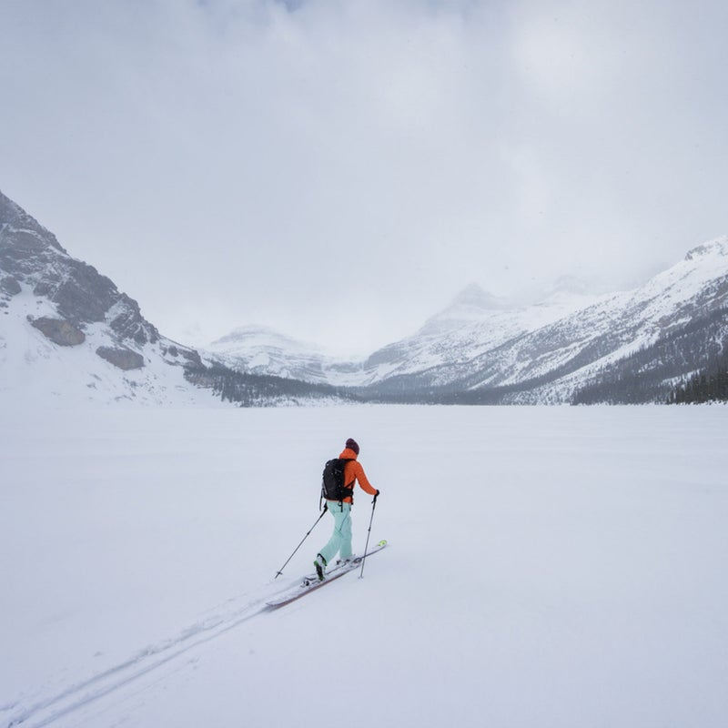 Utah-based skier Kalen Thorien lays a track across a frozen Bow Lake, one of dozens of lakes that line the famous Icefields Parkway in Banff National Park.