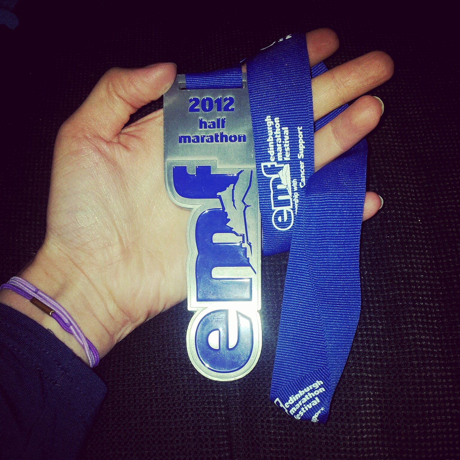 """Williams: The reason behind this is juvenile, admittedly. Clearly the overall shape of the medal was overlooked during the planning stage, because although the front of the medal looks respectable enough (the letters """"emf,"""" for Edinburgh Marathon Festival), once you flip the medal over, it resembles male genitalia."""