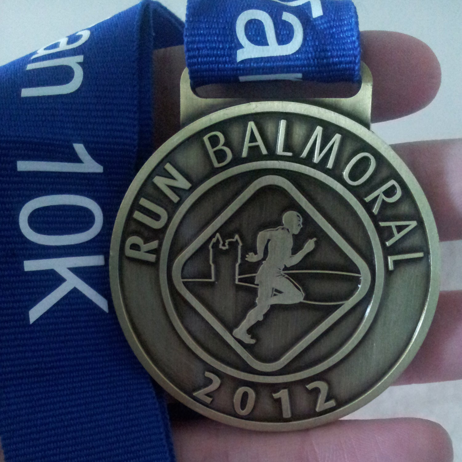 Williams: The running festival has a 5K, a 10K (notorious for a killer hill in the middle), and a 15-mile trail run. All of the medals are just plain, simple, and classy. I also appreciate that they vary the colors and don't stoop to cheap ribbon. Plus, you get to run in the Queen's backyard!