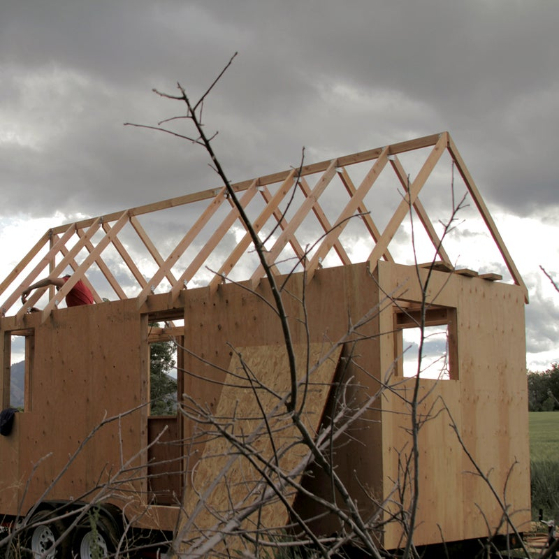"""""""This was Colorado in the mountains during the summer, so we had storms rolling in basically every afternoon,"""" says Mueller. The inside of their house got soaked almost every day until the roof and house wrap were in place, but Colorado's arid climate helped dry things out. If your trailer doesn't drain properly, it could collect rainwater, which will bog down the base. Worried about weather during construction? Look for a covered building site."""