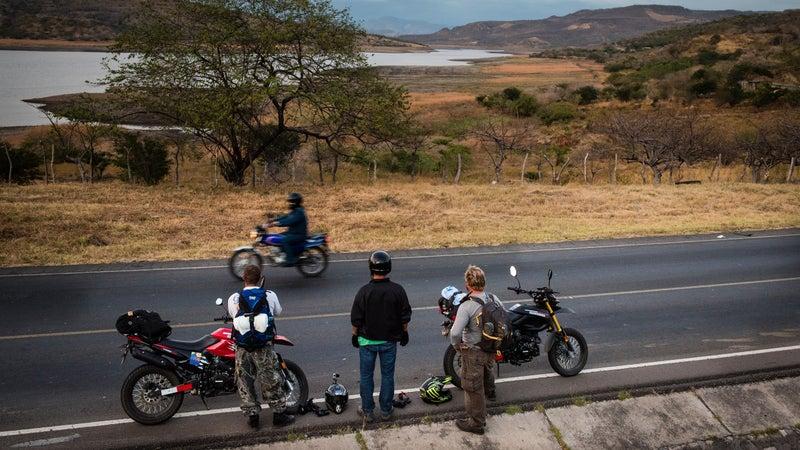 Shawyn Barylski, Jared Rosa, and Greg Chrisman overlooking a reservoir in western Nicaragua.