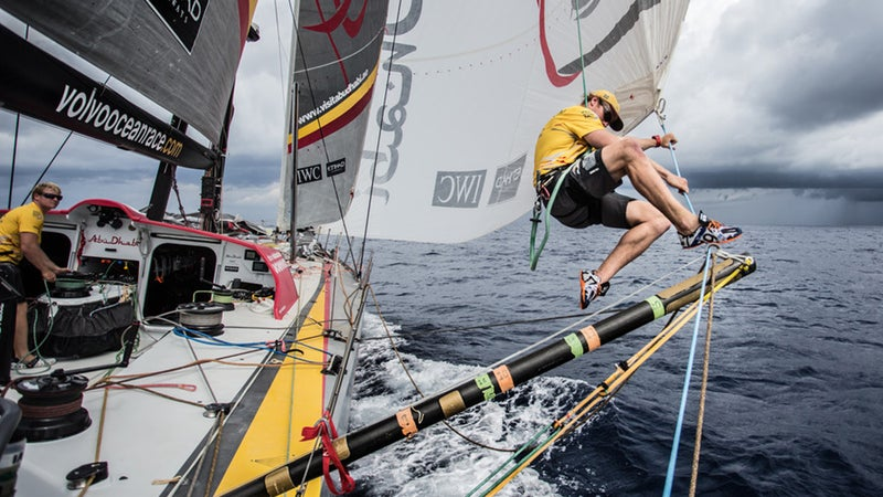 Parkinson grabs the lazy sheet off the A3 before changing sails in the Pacific Ocean en route to Auckland, New Zealand.
