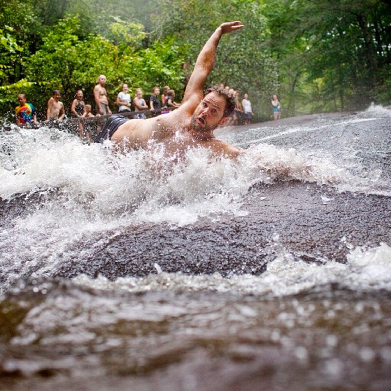 Childhood isn't just for kids anymore. Enjoy Sliding Rock no matter what age you are! #besttowns2015 #brevard #transylvania #landofwaterfalls