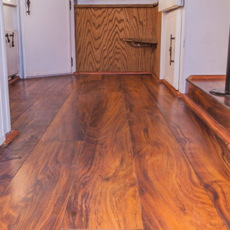 Yes, my camper has a real wood floor. First, it looks great. Second, it makes cleanup a breeze. And it was surprisingly easy to install.
