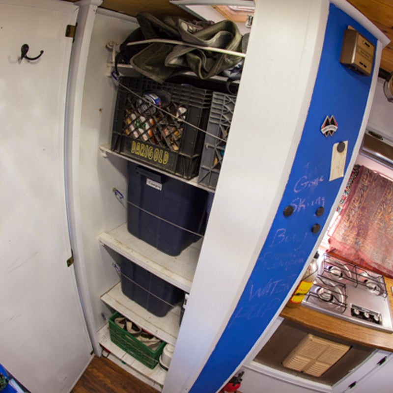 In a 100-square-foot tiny home, you need efficient storage solutions. I turned the bathroom into a closet, built a dresser at the end of the bed for clothes, increased the shelving over the dining room table, and added even more storage under the bed.