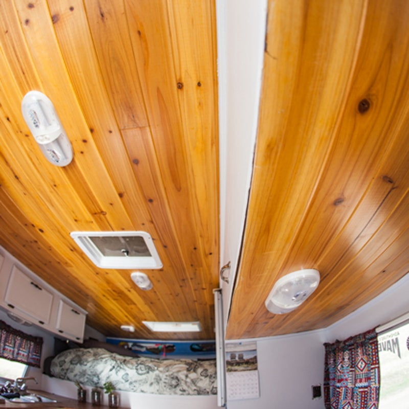 I used a Tung and Groove ceiling, with planks that lock into one another, in my camper: it's lightweight and flexes with the contours of the ceiling, which is great because the roof isn't level. I stained the cedar with Amish oil, and finished it with a coat of polyurethane to make the wood shine.