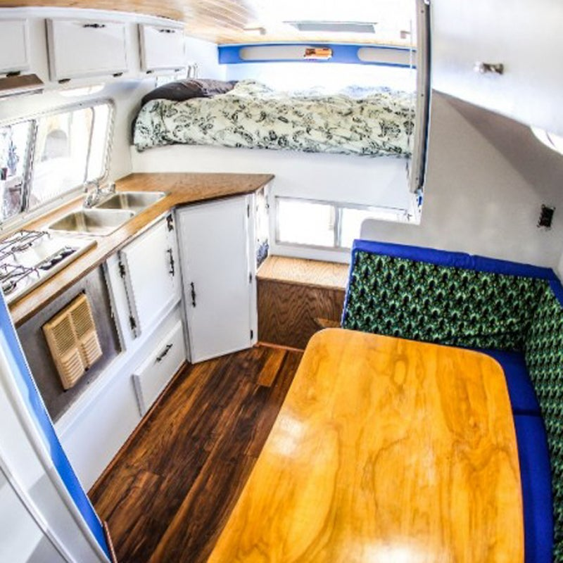 Athlete and photographer Andrew Muse, 26, spent his lifesavings remodeling a 1976 Dynacruiser camper and outfitting it on a 2008 Nissan. His plan: to embark on the adventure of a lifetime in the 100-square-foot adventure vehicle.  The camper only cost $500, but it needed some work before hitting the road. Four months, 360 hours, and $4,000 later, here are the DIY upgrades he made.