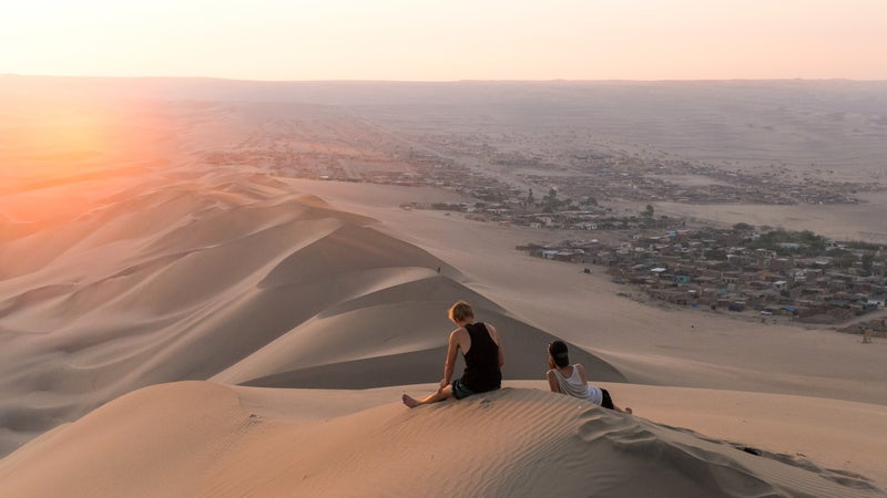 Sun setting over the sand dunes of Huacachina, Peru.