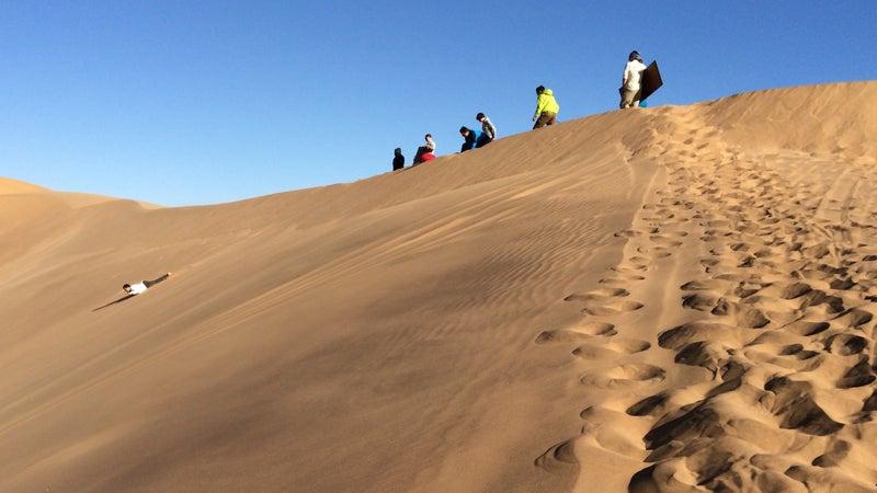 Sandboarding in Swakopmund, Namibia.