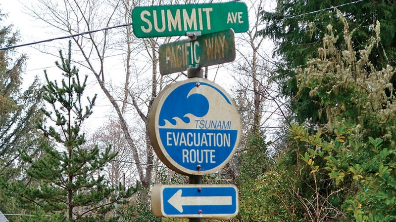 A sign in the coastal town of Seaside, Oregon, seen on March 19, 2011, shows residents the directions for higher ground in case of a tsunami.
