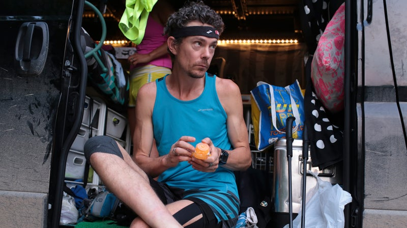 Scott Jurek applies lotion to his feet before running the McAfee Knob Trail on June 11.