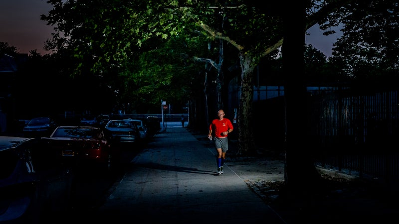Runners completed 5,649 half-mile loops around a block in Queens, New York, to reach 3,100 miles.