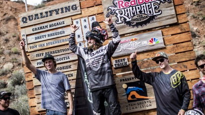 Graham Agassiz celebrates his victory as a top qualifier at the 2014 Red Bull Rampage.