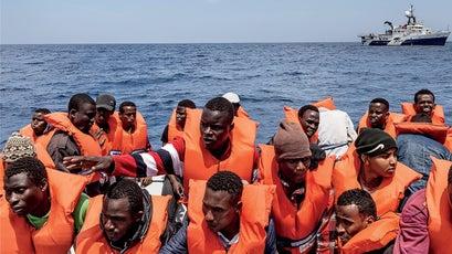 Migrants transfer to rescue boats.