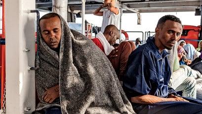 Men rest after their ordeal.