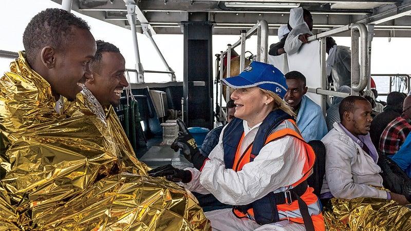 Regina Catrambone assists migrants.