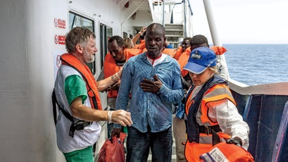 Regina Catrambone, right, and Canadian doctor Simon Bryant aid a Nigerian man who fled Boko Haram's reign of terror.