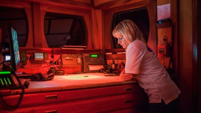 Regina Catambrone looks at the navigation chart on June 10, 2015 during their mission in the Mediterranean Sea.