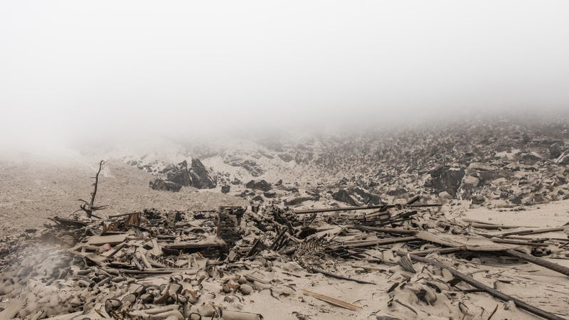 The remains of a wood and stone house in small village of Singdum, just hours after the earthquake unleashed multiple avalanches upon the Langtang valley region. Saturday, April 25, 2015.