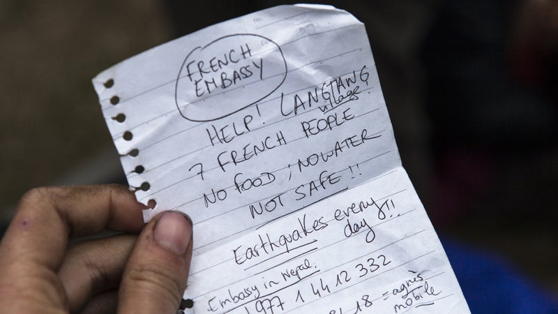 A handwritten note calling for help and carried by those airlifted out.