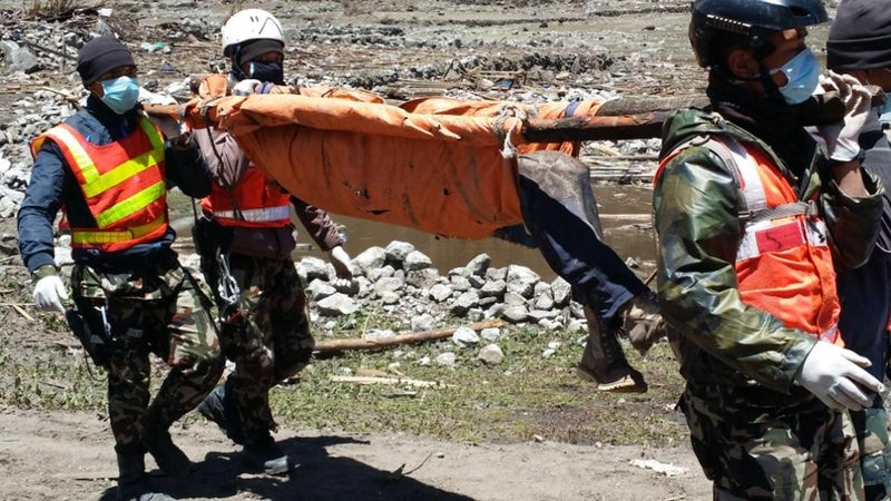 Four Nepalese Army members use a makeshift stretcher during the rescue.