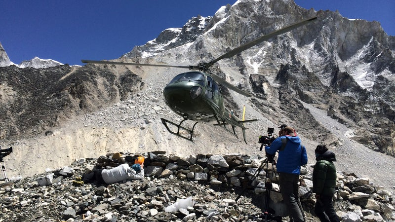 Harvey (right) films a Nepali military helicopter landing for a Beck Weathers rescue sequence at basecamp.