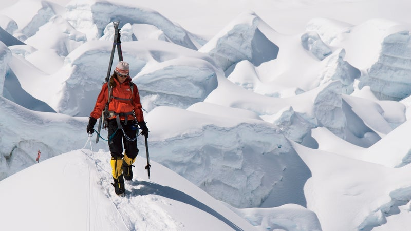 """Kit DesLauriers makes her way through Everest's treacherous Khumbu Icefall on September 17, 2006. """"The Icefall is one of the few places where you can make all the right decisions and it could still collapse,"""" says photographer Jimmy Chin."""