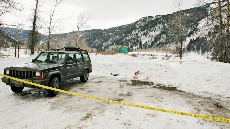 Blanning's Cherokee at the spot where police found his body.