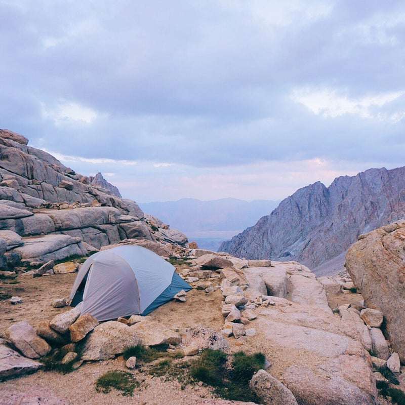 I take images with whatever is handy, but generally I like to take photographs with my mirrorless camera or my SLR. When it comes to landscape or astrophotography, these tools get me a lot closer to creating the image I see or have in mind.This image was taken on my last night of my JMT hike, when I found a campsite off the trail below Mount Whitney that had an incredible view. I got an insane sunset and I spotted a coyote loping along in the distance. In the morning I woke to fog drifting over the lake and burning off in the early sunshine.