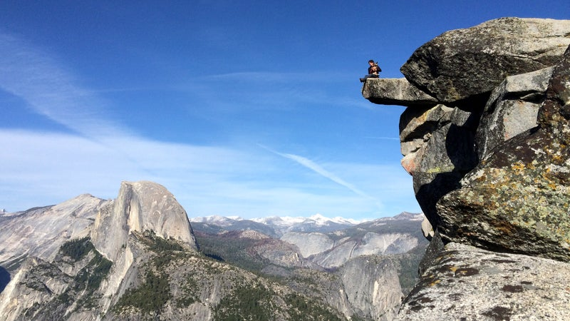 Dean Potter sitting with Whisper at Glacier Point in Yosemite.