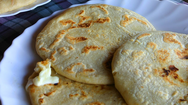 Pupusas stuffed with cheese.